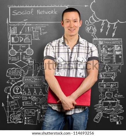 Social network idea concept, man with laptop in his hands, looking on camera - stock photo