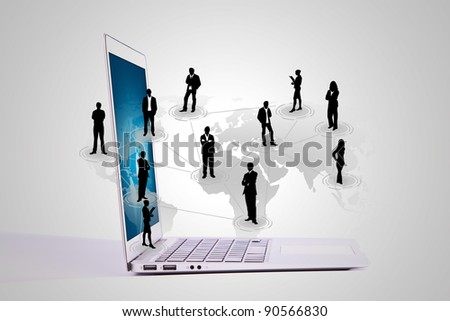 Social networking concept : Laptop with social network on world map - stock photo