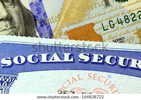 Social security card and US currency  - stock photo