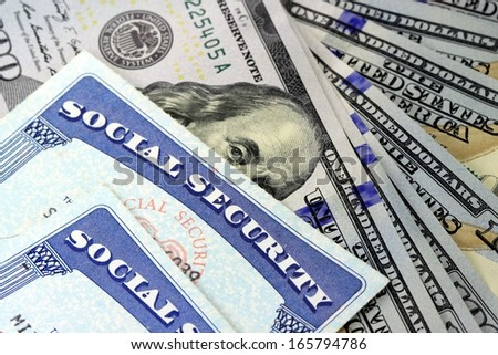Social security card and US currency - Retirement Concept Social Security Benefits - stock photo