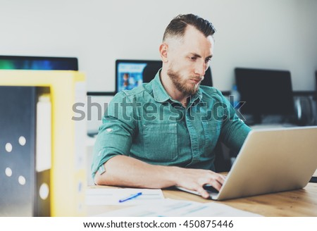 Social Trading Online Public Relations Manger Analyze Reports.Men working wood table Modern Interior Office.Businessman Work Coworking Studio.Using Digital Laptop.Blurred Background.Business Startup - stock photo
