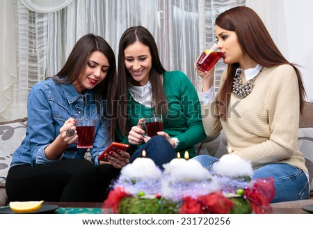 socializing friend for Christmas with a cup of tea/Christmas with a cup of tea - stock photo