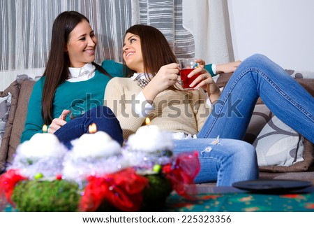 socializing friend for Christmas with a cup of tea/socializing friend for Christmas - stock photo