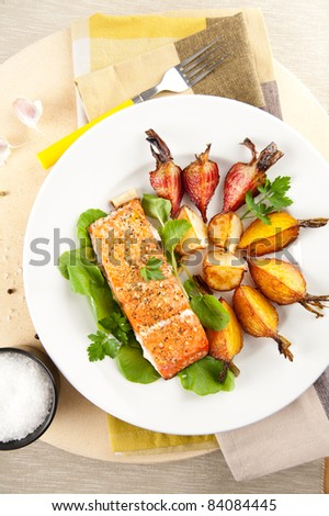 Sockeye Salmon Baked with Various Root Vegetables - stock photo