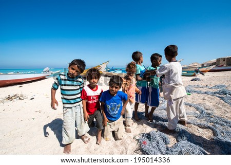 SOCOTRA, YEMEN - JAN 12, 2014: Unidentified Yemeni children on the beach of the Island of Socotra. Children in Socotra live in poverty and grow without education