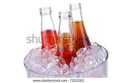 Soda Bottles in Ice Bucket isolated over white - stock photo