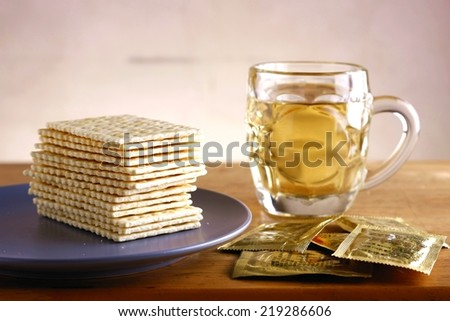 Soda Crackers and a cup of tea Photo of a stack of soda crackers and a cup of tea - stock photo