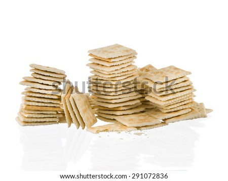 Soda crackers stacks half eaten isolated on white background