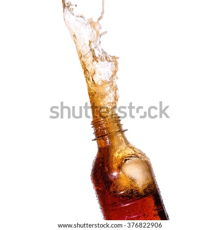 Soda splash out of bottle on white background. - stock photo