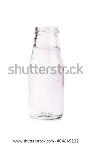 Soda water in glass bottle isolated on white background.
