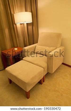Sofa and night stand lamp - stock photo