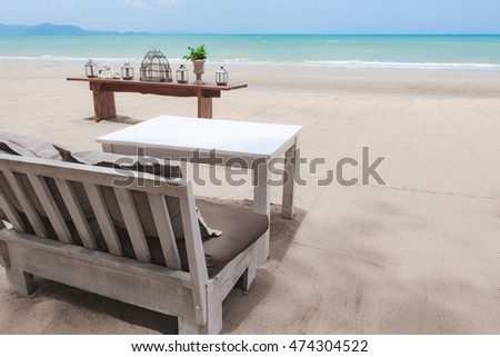 Sofa and table on the beach in Pattaya, Thailand.