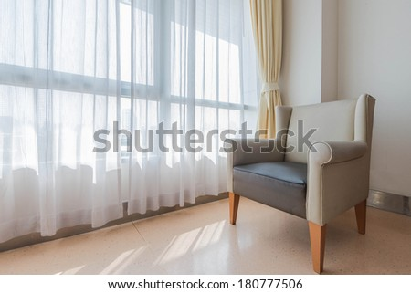 Sofa Chair in the corner of the room and window - stock photo
