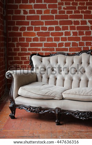 sofa on a background of red brick wall
