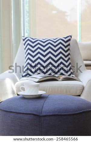Sofa table with coffee and armchair with pillow, Home interior decoration