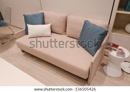 Sofa with some pillows. Interior design. Fragment. - stock photo