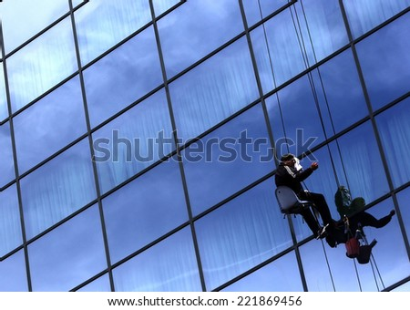 Sofia, Bulgaria - April 12, 2013: Hygienists are cleaning windows of a hotel in the center of Bulgaria's capital Sofia.