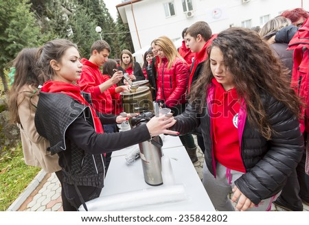 Sofia, Bulgaria - December 5, 2014: Members from Bulgarian Red Cross Youth (BRCY) voluntary youth organization are giving coffee, tea and soup to other members as participating in a training. - stock photo