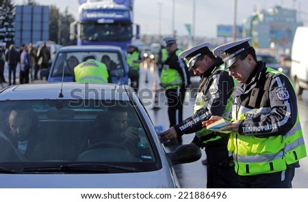 Sofia, Bulgaria - December 4, 2012: Traffic police conductes inspections of motor vehicles on ring road of Sofia, Bulgaria. - stock photo