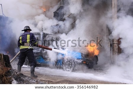 Sofia, Bulgaria - February 18, 2011: Sofia, Bulgaria -  Firefighter extinguish a burning car on city, Sofia, Bulgaria