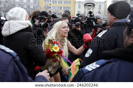 SOFIA, BULGARIA - JANUARY 21, 2012: Activists from Ukrainian feminist group FEMEN shout slogans during a topless protest in front of Bulgaria's Parliament building on January 21, 2012, in Sofia. - stock photo
