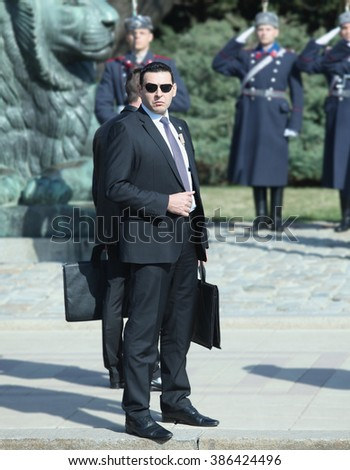 Sofia, Bulgaria - Mart 3, 2016: Bodyguard is securing a public event at Alexander Nevski square during the official  celebration of the National holiday of Bulgaria