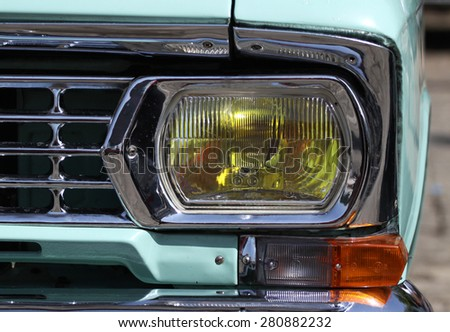 Sofia, Bulgaria - May 23, 2015: Retro parade old retro or vintage car or automobile front side and back side with front lights or headlights and radiator grill. - stock photo