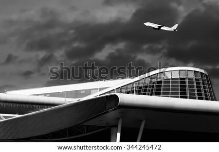 SOFIA, BULGARIA - NOVEMBER 27, 2015. Plane takes off from Sofia airport Terminal 2, black and white image   - stock photo