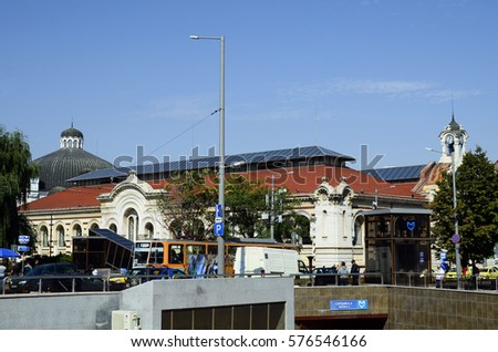 SOFIA, BULGARIA - SEPTEMBER 25: Unidentified people on Serdica square with Banya Bashi mosque, Metro station, Central Sofia Market building, cupola of synagogue, September 25, 2016 in Sofia, Bulgaria