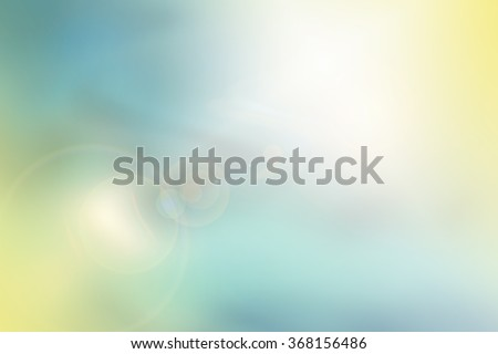 Soft abstract background in pastel colors of teal, blue and yellow.