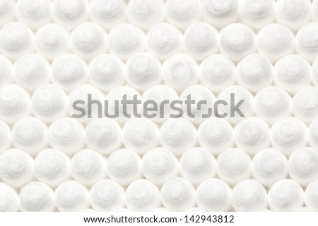 Soft and abstract background created by arranging uniformly heads of cotton buds uniformly, may use as background - stock photo