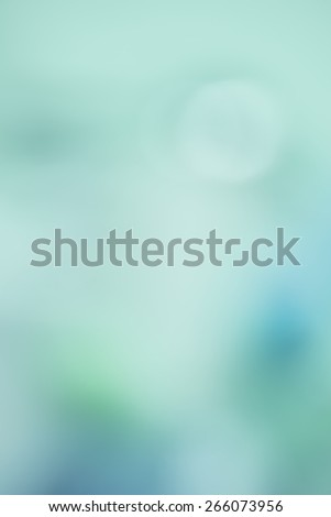 Soft and Beautiful Wintry Blur Abstract Background  in Dusty Blue, Cyan, Turquoise and green Tones with room or space for text, copy, your words. Vertical that works as Horizontal, monochromatic  - stock photo