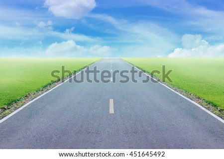 Soft and blur high speed road with blue skies background.