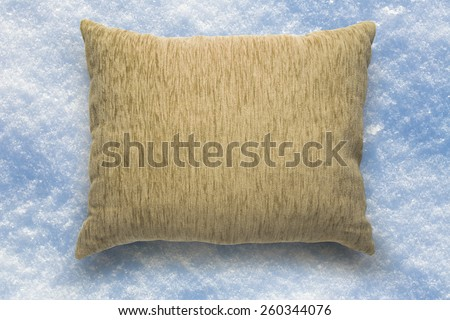 Soft blank beige pillow on snow background - stock photo