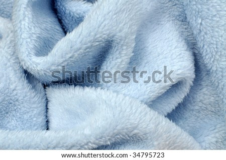 Soft blue baby blanket closeup - stock photo