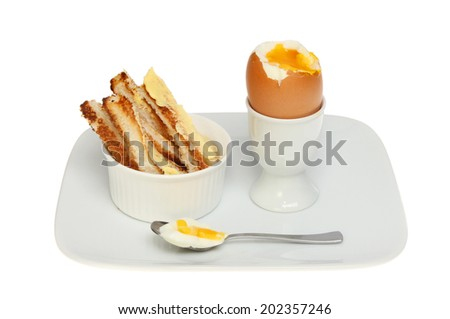 Soft boiled egg and toast soldiers on a plate isolated against white - stock photo