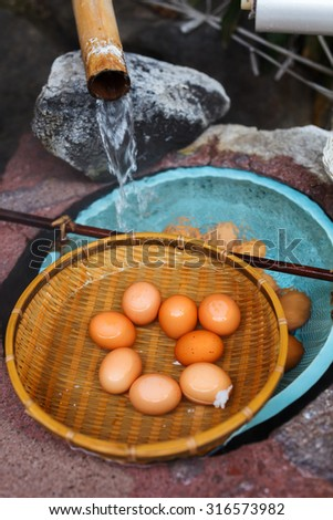 Soft boiled eggs cooked at hot spring water - stock photo