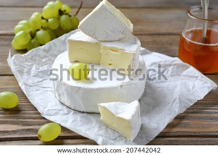soft cheese with a white mold, camembert, food closeup