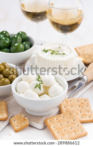 soft cheeses, crackers and pickles for wine, vertical, top view, close-up - stock photo