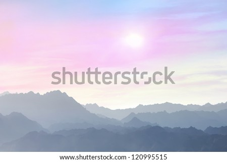 Soft color sunrise over mountains silhouettes
