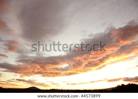 Soft colors in a beautiful sky. New Zealand scenic. - stock photo