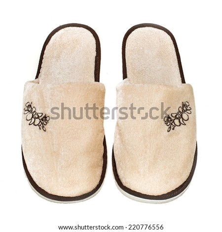 Soft comfortable and warm slippers to wear in the house. solated on white background - stock photo
