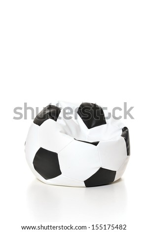 Soft cushion in shape of soccer ball on white background
