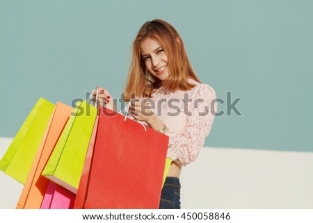 Soft focus and Blurry of happiness, consumerism, sale and people concept - smiling young woman asian with shopping bags - stock photo