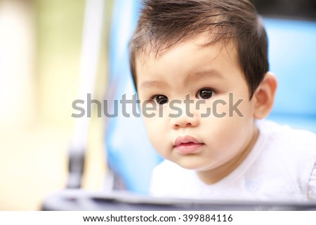 Soft focus and selective focus of a Sweet little boy in the prams (outdoors - Close-up) - stock photo