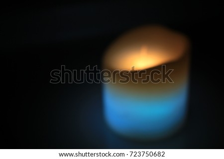 Soft Focus Blue Candle Background