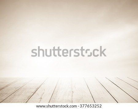 Soft focus clouds sky background brown sepia tone with old wood floor. Blur sky white sunlight day time. Abstract blurred on vacation summer ocean beach. Wooden stage for watching nature. - stock photo