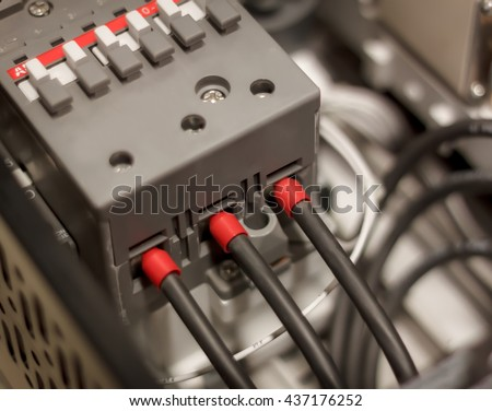 soft focus electrical engineering background the electrical wire connect magnetic contactor in control panel cabinet. - stock photo