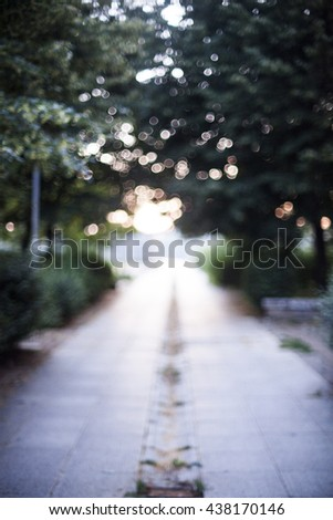 Soft focus image of a pedestrian path at sunset - stock photo
