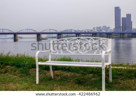 Soft focus lonely chair beside the river